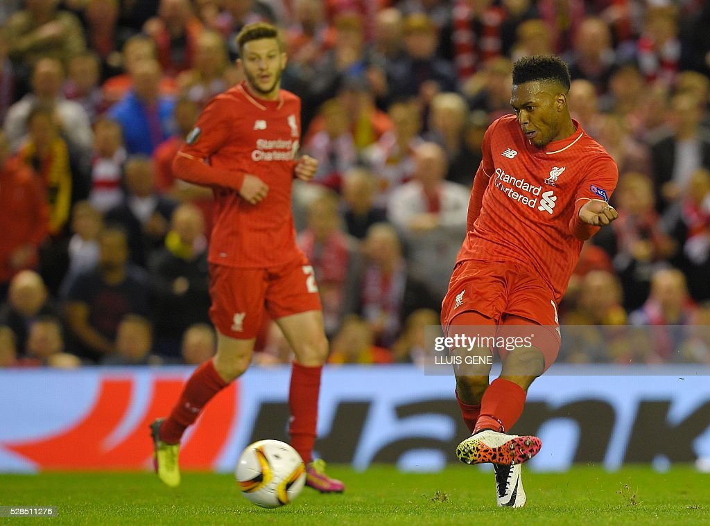 Liverpool's English striker Daniel Sturridge (R) scores his team's second goal during the UEFA Europa League semi-final second leg football match between Liverpool and Villarreal CF at Anfield in Liverpool, northwest England on May 5, 2016. / AFP / LLUIS