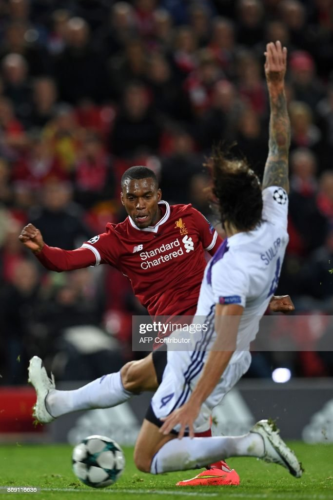 Liverpool's English striker Daniel Sturridge (L) shoots to score their third goal during the UEFA Champions League Group E football match between Liverpool and NK Maribor at Anfield in Liverpool, north-west England on November 1, 2017. Liverpool won the game 3-0. / AFP PHOTO / Paul ELLIS