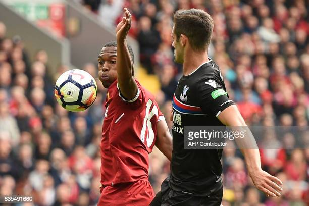 Liverpool's English striker Daniel Sturridge vies with Crystal Palace's English defender Scott Dann during the English Premier League football match...