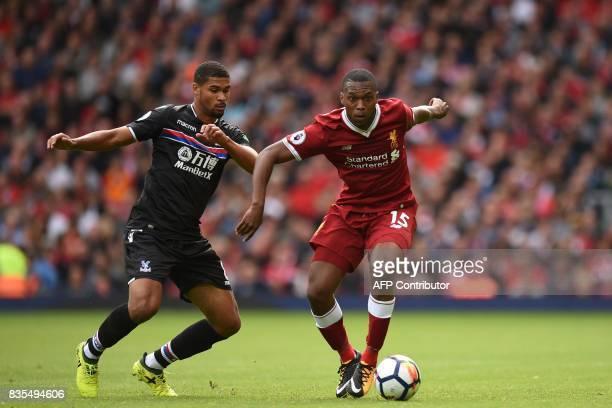 Liverpool's English striker Daniel Sturridge vies with Crystal Palace's English midfielder Ruben LoftusCheek during the English Premier League...