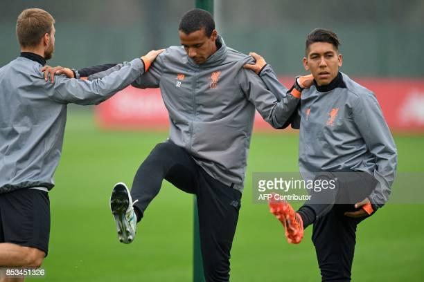 Liverpool's Estonian defender Ragnar Klavan Liverpool's Germanborn Cameroonian defender Joel Matip and Liverpool's Brazilian midfielder Roberto...