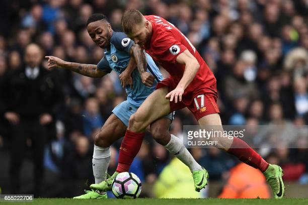 Liverpool's Estonian defender Ragnar Klavan vies with Manchester City's English midfielder Raheem Sterling during the English Premier League football...