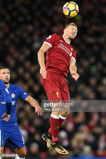 Liverpool's Estonian defender Ragnar Klavan wins a header during the English Premier League football match between Liverpool and Chelsea at Anfield...