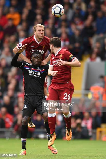 Liverpool's Estonian defender Ragnar Klavan wins ahead from Crystal Palace's Zaireborn Belgian striker Christian Benteke during the English Premier...