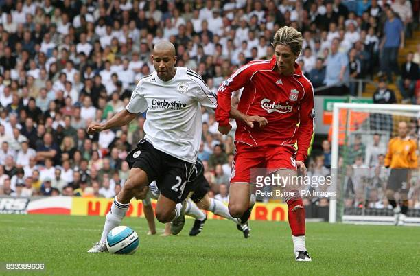 Liverpool's Fernando Torres and Derby County's Tyrone Mears battle for the ball