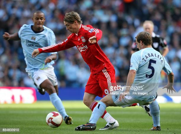 Liverpool's Fernando Torres and Manchester City's Pablo Zabaleta battle for the ball