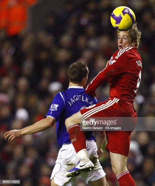Liverpool's Fernando Torres beats Everton's Phil Jagielka to the ball during the Barclays Premier League match at Anfield Liverpool