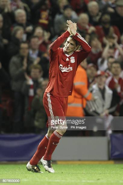 Liverpool's Fernando Torres celebrates after scoring the fourth goal of the game