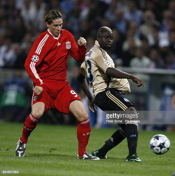 Liverpool's Fernando Torres closes down Marseille's Modeste M'Bami during the UEFA Champions League match at the Stade Velodrome Marseille France