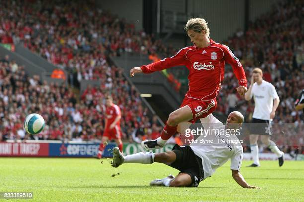 Liverpool's Fernando Torres is challenged by Derby County's Tyrone Mears as they battle for the ball