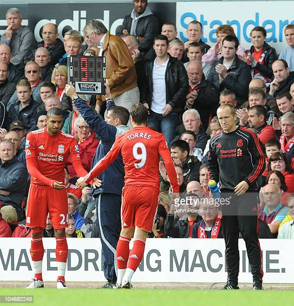 Liverpool's Fernando Torres is substituted for David Ngog of Liverpool during the Barclays Premier league match between Liverpool and Blackpool at...