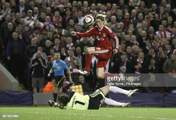 Liverpool's Fernando Torres scores the fourth goal of the game past Benfica goalkeeper Jose Moreira
