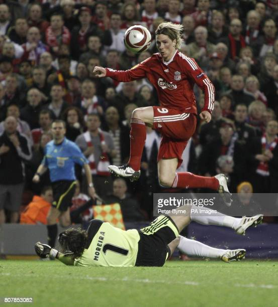 Liverpool's Fernando Torres scores the fourth goal of the game past Benfica goalkeeper Jose Moreira during the Europa League match at Anfield...
