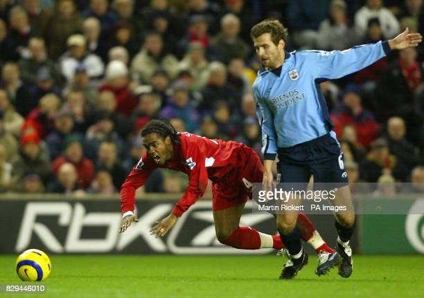 Liverpool's Florent SinamaPongolle is challenged for the ball by Southampton's Andreas Jakobsson