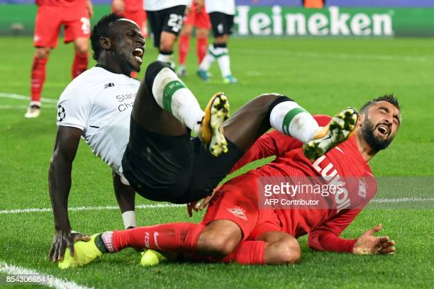 Liverpool's forward from Senegal Sadio Mane and Spartak Moscow's midfielder from Russia Alexander Samedov vie for the ball during the UEFA Champions...