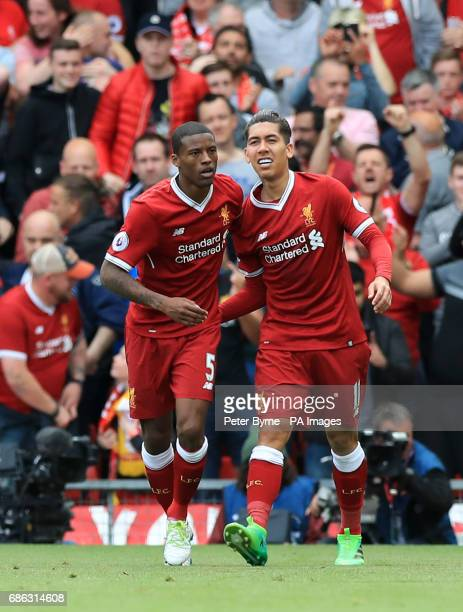 Liverpool's Georginio Wijnaldum celebrates scoring his side's first goal of the game with Roberto Firmino during the Premier League match at Anfield...