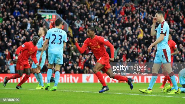 Liverpool's Georginio Wijnaldum celebrates scoring his side's first goal during the Premier League match at Anfield Liverpool