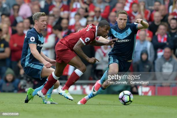 Liverpool's Georginio Wijnaldum is tackled by Middlesbrough's Adam Forshaw during the Premier League match between Liverpool and Middlesbrough at...