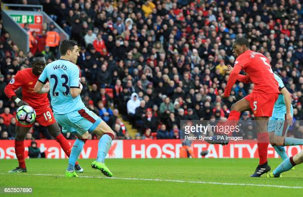 Liverpool's Georginio Wijnaldum scores his side's first goal during the Premier League match at Anfield Liverpool
