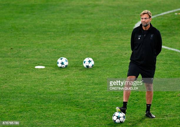Liverpool's German coach Jurgen Klopp attends a training session at Ramon Sanchez Pizjuan stadium in Sevilla on November 20 2017 on the eve of the...