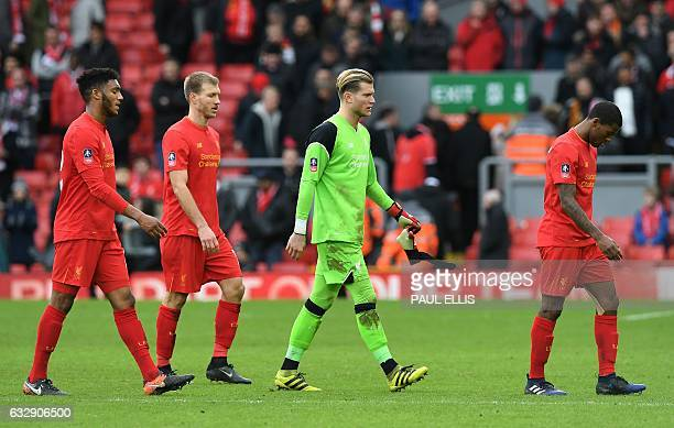 Liverpool's German goalkeeper Loris Karius leave the pitch following the English FA Cup fourth round football match between Liverpool and...