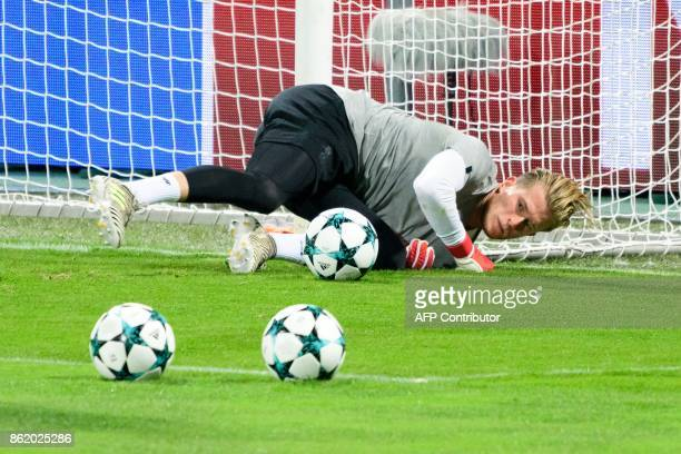 Liverpool's German goalkeeper Loris Karius reacts during a training session on the eve of the UEFA Champions League Group E football match between NK...