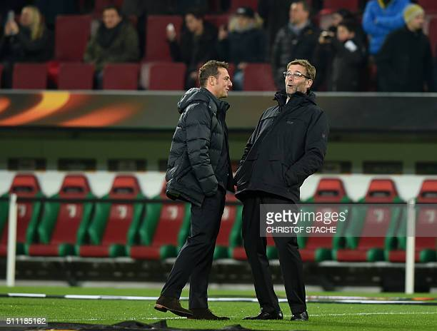 Liverpool's German headcoach Juergen Klopp and Augsburg's headcoach Markus Weinzierl share a laugh ahead of the UEFA Europa League Round of 32...