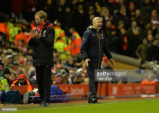 Liverpool's German manager Jurgen Klopp and Arsenal's French manager Arsene Wenger react during the English Premier League football match between...