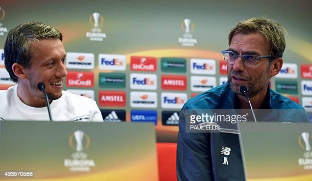 Liverpool's German manager Jurgen Klopp and Brazilian midfielder Lucas give a press conference in Liverpool northwest England on October 21 on the...