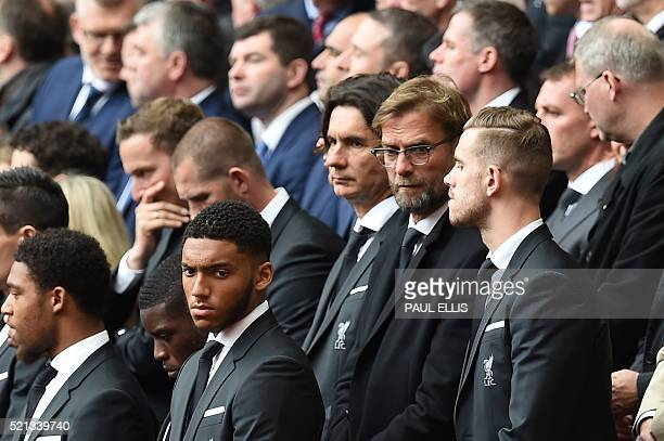 Liverpool's German manager Jurgen Klopp and Liverpool's English midfielder Jordan Henderson attend a memorial service at Anfield in Liverpool north...