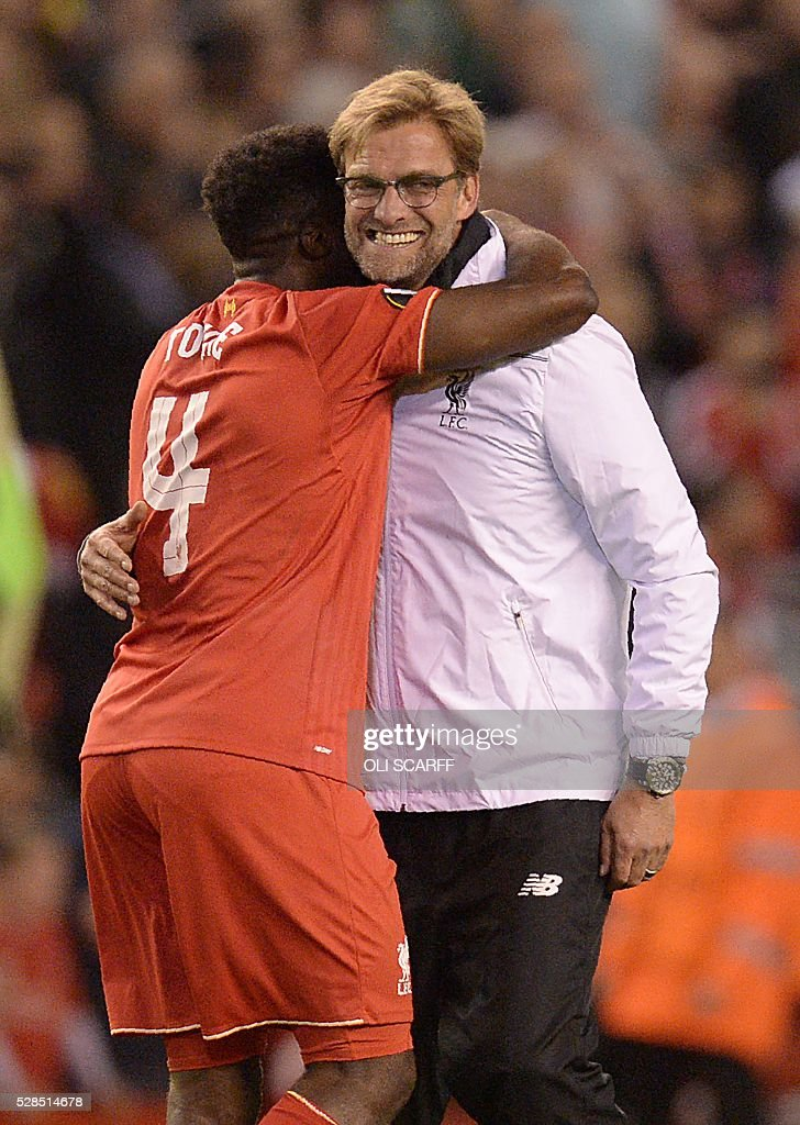 Liverpool's German manager Jurgen Klopp (R) and Liverpool's Ivorian defender Kolo Toure celebrate at the final whistle after a 3-0 victory during the UEFA Europa League semi-final second leg football match between Liverpool and Villarreal CF at Anfield in Liverpool, northwest England on May 5, 2016. / AFP / OLI