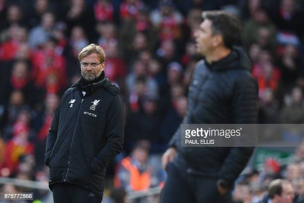 Liverpool's German manager Jurgen Klopp and Southampton's Argentinian manager Mauricio Pellegrino watches his players from the touchline during the...