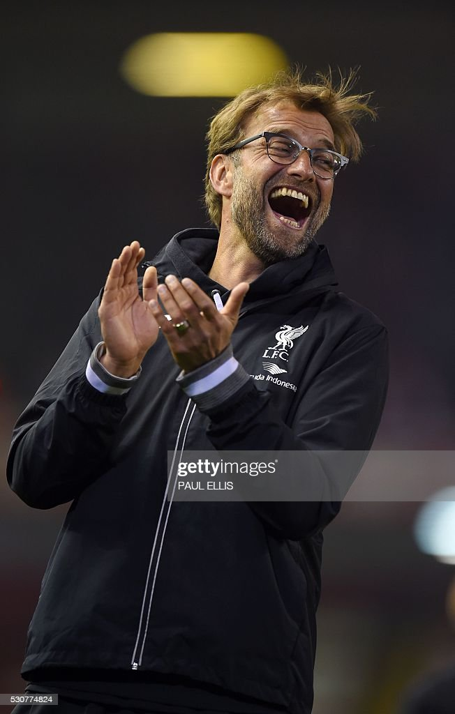 Liverpool's German manager Jurgen Klopp applauds after a 1-1 draw at the end of the English Premier League football match between Liverpool and Chelsea at Anfield in Liverpool, north west England on May 11, 2016. / AFP / PAUL ELLIS / RESTRICTED TO EDITORIAL USE. No use with unauthorized audio, video, data, fixture lists, club/league logos or 'live' services. Online in-match use limited to 75 images, no video emulation. No use in betting, games or single club/league/player publications. /