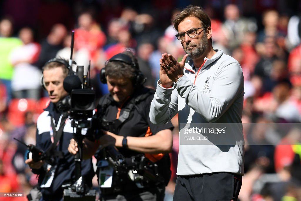 Liverpool's German manager Jurgen Klopp applauds after the English Premier League football match between Liverpool and Southampton at Anfield in Liverpool, north west England on May 7, 2017. / AFP PHOTO / Paul ELLIS / RESTRICTED TO EDITORIAL USE. No use with unauthorized audio, video, data, fixture lists, club/league logos or 'live' services. Online in-match use limited to 75 images, no video emulation. No use in betting, games or single club/league/player publications. /
