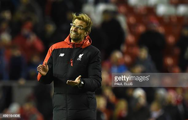 Liverpool's German manager Jurgen Klopp applauds on the pitch after the English Premier League football match between Liverpool and Swansea City at...