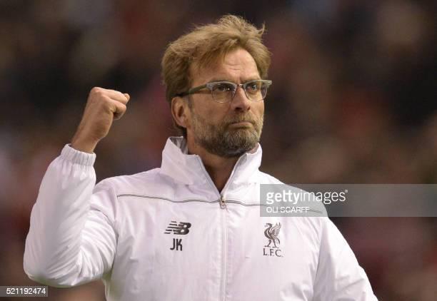 Liverpool's German manager Jurgen Klopp celebrates after winning the UEFA Europa league quarterfinal second leg football match between Liverpool and...
