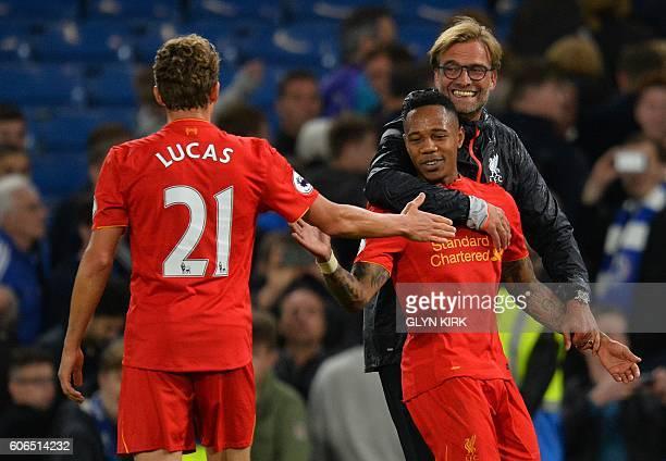 Liverpool's German manager Jurgen Klopp celebrates with Liverpool's English defender Nathaniel Clyne and Liverpool's Brazilian midfielder Lucas Leiva...