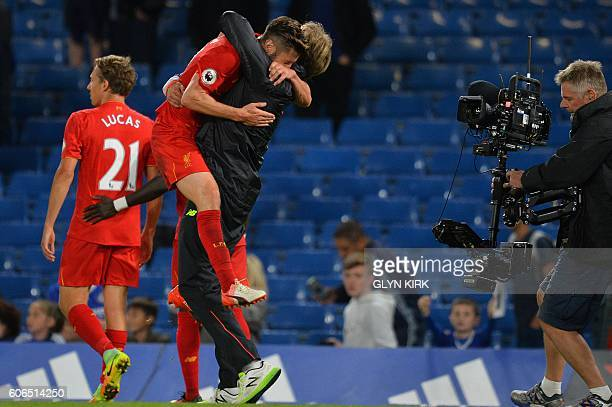 Liverpool's German manager Jurgen Klopp celebrates with Liverpool's English midfielder Adam Lallana following the English Premier League football...