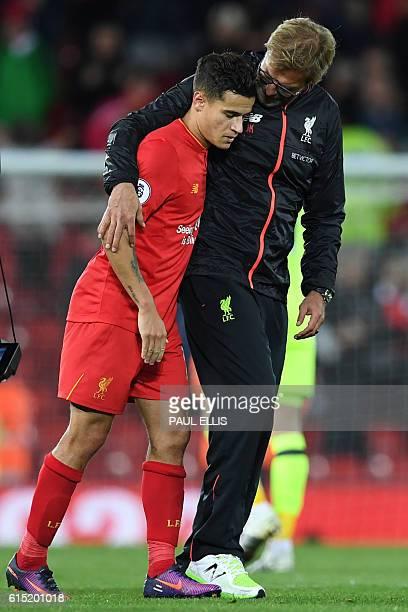 Liverpool's German manager Jurgen Klopp embraces Liverpool's Brazilian midfielder Philippe Coutinho after the English Premier League football match...