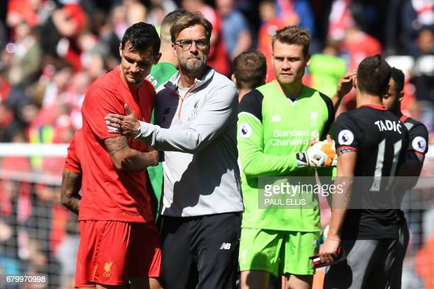Liverpool's German manager Jurgen Klopp embraces Liverpool's Croatian defender Dejan Lovren after the English Premier League football match between...