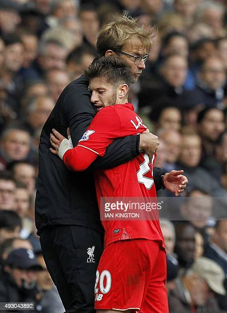 Liverpool's German manager Jurgen Klopp embraces Liverpool's English midfielder Adam Lallana as he is substituted during the English Premier League...