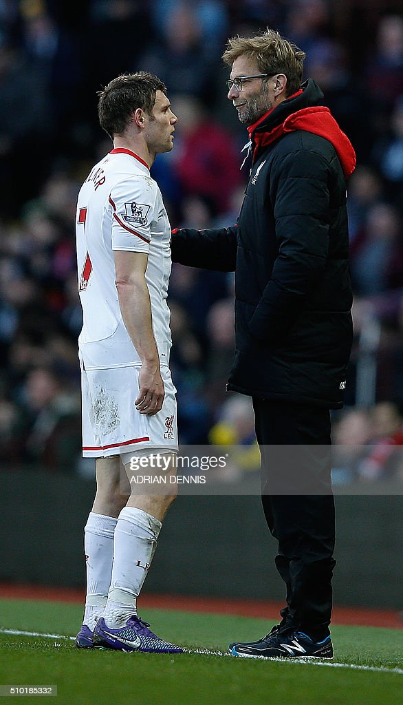 Liverpool's German manager Jurgen Klopp (R) gestures as he talks with Liverpool's English midfielder James Milner on the touchline during the English Premier League football match between Aston Villa and Liverpool at Villa Park in Birmingham, central England on February 14, 2016. / AFP / ADRIAN DENNIS / RESTRICTED TO EDITORIAL USE. No use with unauthorized audio, video, data, fixture lists, club/league logos or 'live' services. Online in-match use limited to 75 images, no video emulation. No use in betting, games or single club/league/player publications. /