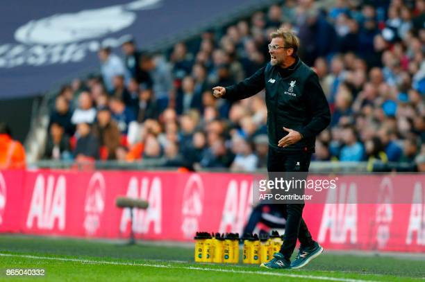 Liverpool's German manager Jurgen Klopp gestures on the touchline after Salah scores their first goal during the English Premier League football...