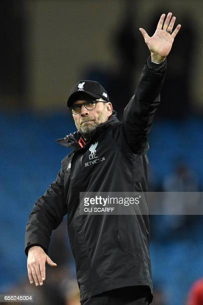 Liverpool's German manager Jurgen Klopp gestures to supporters on the pitch after the English Premier League football match between Manchester City...