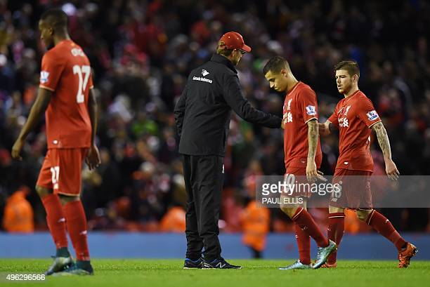 Liverpool's German manager Jurgen Klopp greets his players after losing the English Premier League football match between Liverpool and Crystal...