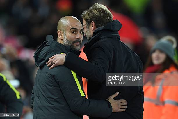 Liverpool's German manager Jurgen Klopp greets Manchester City's Spanish manager Pep Guardiola ahead of the English Premier League football match...