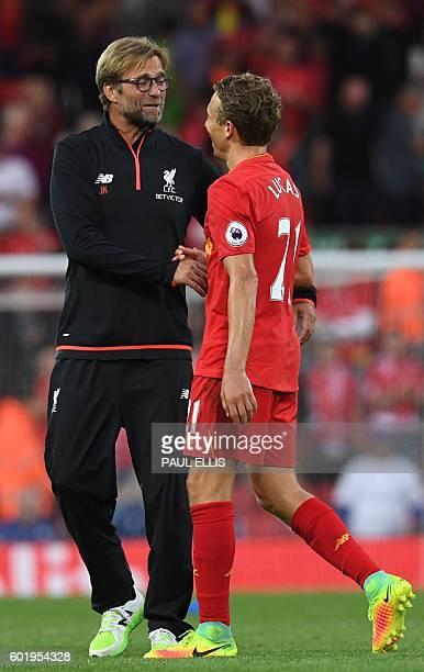 Liverpool's German manager Jurgen Klopp L0 has a word with Liverpool's Brazilian midfielder Lucas Leiva after the English Premier League football...