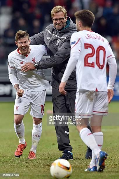 Liverpool's German manager Jurgen Klopp Liverpool's Spanish defender Alberto Moreno and Liverpool's English midfielder Adam Lallana celebrate their...