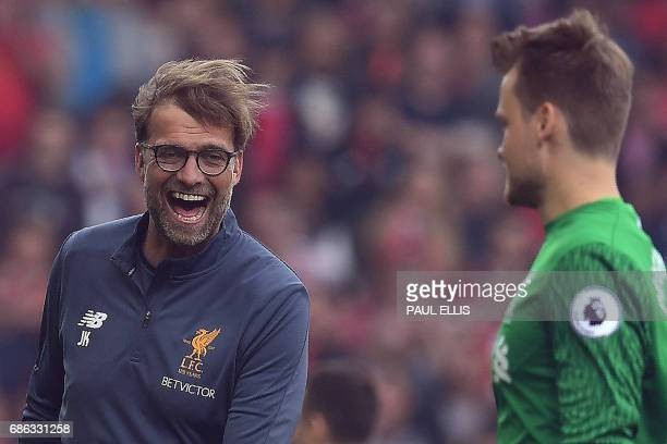 Liverpool's German manager Jurgen Klopp reacts with Liverpool's Belgian goalkeeper Simon Mignolet during the English Premier League football match...