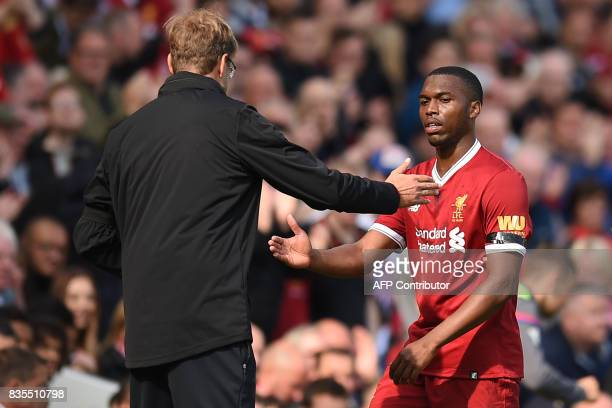 Liverpool's German manager Jurgen Klopp shakes hands with Liverpool's English striker Daniel Sturridge as he is substituted during the English...